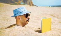 guy stuck in sand reading book